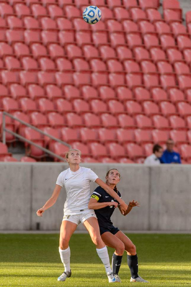 Trent Nelson  |  The Salt Lake Tribune Logan's Kaycee Larsen and Juan Diego's Katie Whittington (2), as Logan faces Juan Diego in the 3A High School Girl's Soccer Championship game at Rio Tinto Stadium in Sandy, Saturday October 22, 2016.