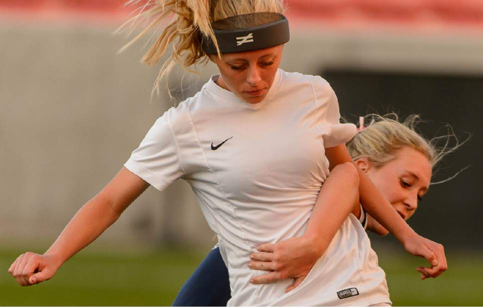 Trent Nelson  |  The Salt Lake Tribune Juan Diego's Heaven Kelley (16) and Logan's Mikaela Arnold as Logan faces Juan Diego in the 3A High School Girl's Soccer Championship game at Rio Tinto Stadium in Sandy, Saturday October 22, 2016.