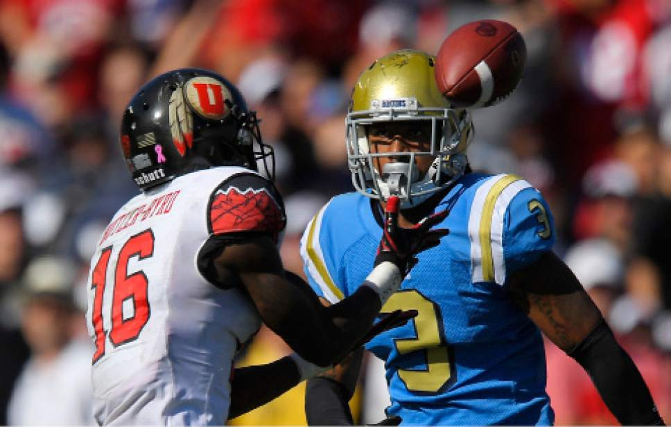 Utah wide receiver Cory Butler-Byrd, left, makes a catch as UCLA defensive back Randall Goforth defends during the first half of an NCAA college football game, Saturday, Oct. 22, 2016, in Pasadena, Calif. (AP Photo/Mark J. Terrill)