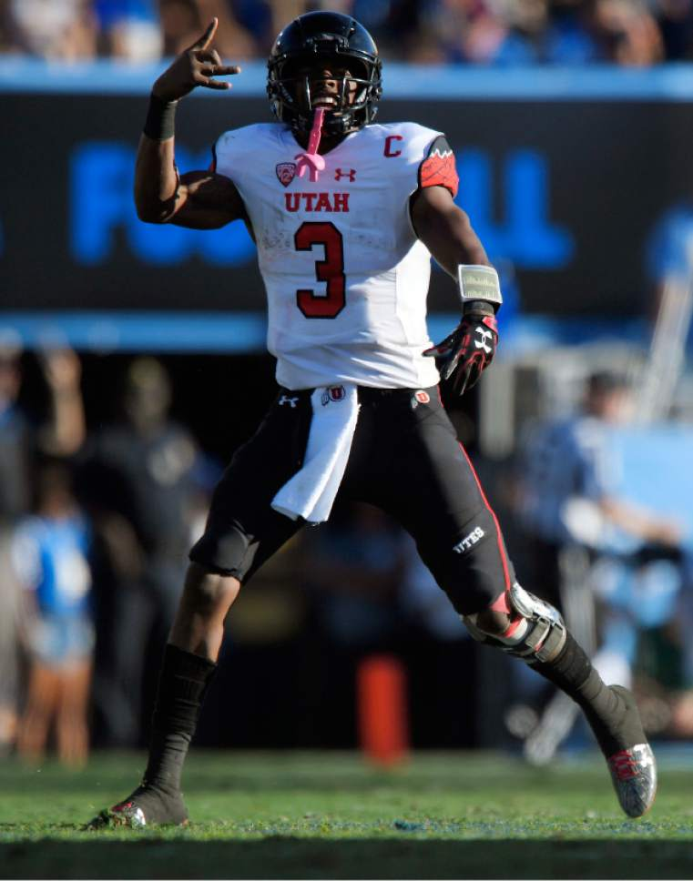 Utah quarterback Troy Williams celebrates after they scored a touchdown during the second half of an NCAA college football game against UCLA, Saturday, Oct. 22, 2016, in Pasadena, Calif. Utah won 52-45. (AP Photo/Mark J. Terrill)
