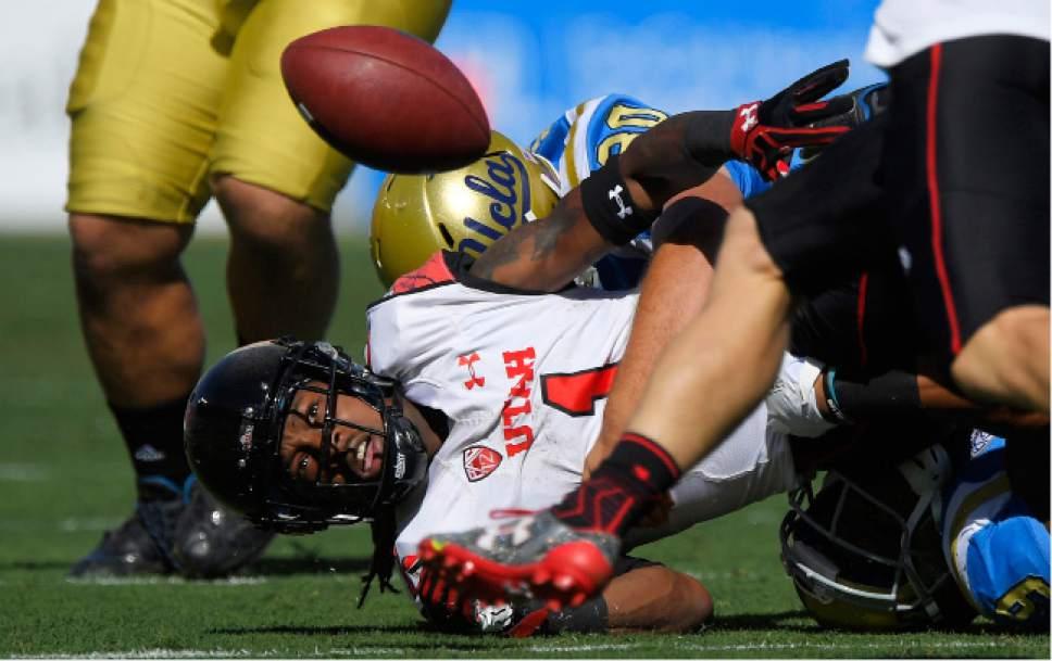 Utah punt returner Boobie Hobbs, below, fumbles the ball as UCLA long snapper Johnny Den Bleyker hit him during a punt return in the first half of an NCAA college football game, Saturday, Oct. 22, 2016, in Pasadena, Calif. Utah recovered the ball. (AP Photo/Mark J. Terrill)