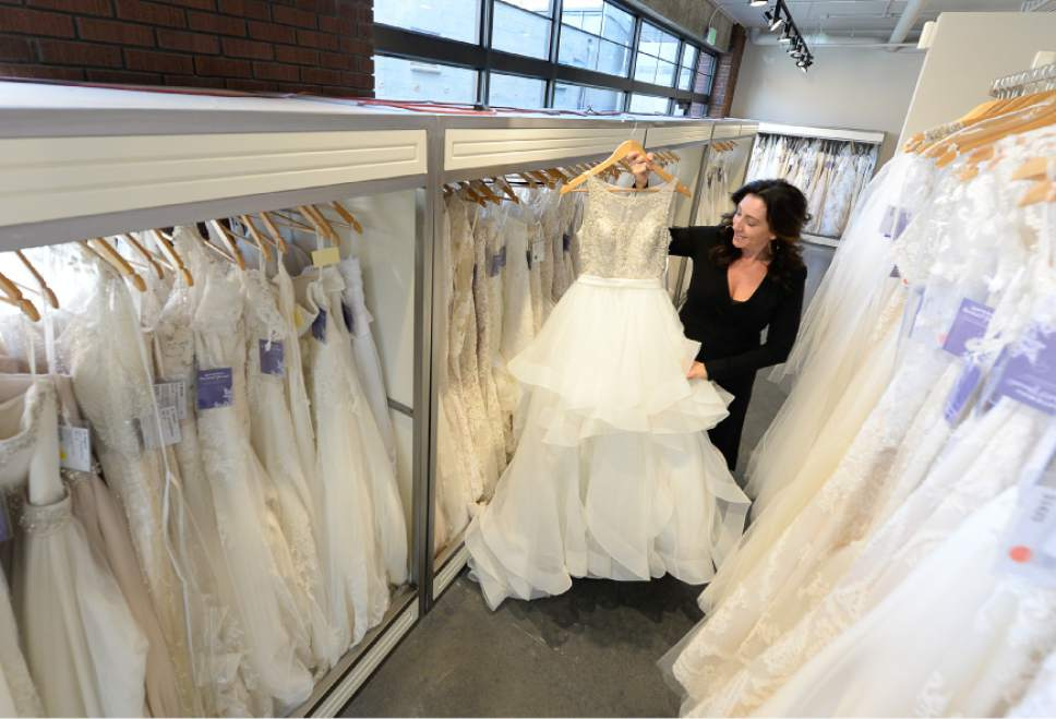 "Francisco Kjolseth | The Salt Lake Tribune Nicole Thomas, owner of Gateway Bridal & Prom gives a tour of her store, that she recently relocated to the North end of Pioneer Park after being across from the downtown homeless shelter since 2008. ""I love this area and I want to be part of the solution,"" she said while discussing the criminal elements of the shelter that made it unbearable and worrisome for her staff at night. A nearby move seemed to be the best solution so she could maintain the store's name, gain square footage and support from adjacent businesses."