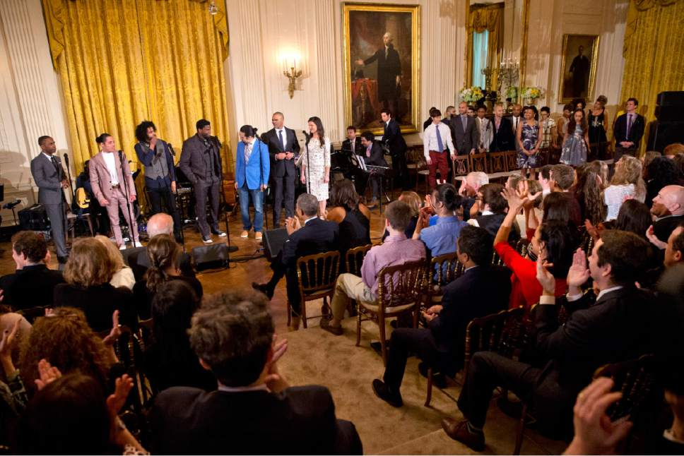 "The audience, including President Barack Obama, and first lady Michelle Obama, center front, applaud as actors from left, Leslie Odom Jr., Anthony Ramos, Daveed Diggs, Okieriete Onaodowan, Lin-Manuel Miranda, Christopher Jackson, and Phillipa Soo, finish performing the song ""Alexander Hamilton"" from the Broadway play ""Hamilton"" in the East Room of the White House, in Washington, Monday, March 14, 2016. (AP Photo/Jacquelyn Martin)"