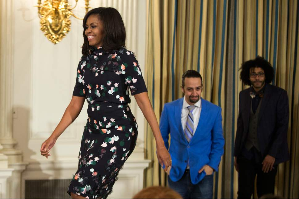 "First lady Michelle Obama, left, actor Lin-Manuel Miranda, center, and actor Daveed Diggs arrive for an event with the cast of the Broadway play ""Hamilton"" in the State Dining Room of the White House, on Monday, March 14, 2016, in Washington. (AP Photo/Evan Vucci)"