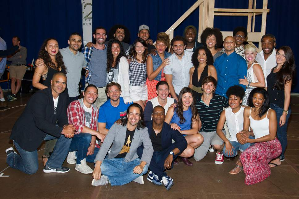 "Author and star of the Broadway-bound musical ""Hamilton,"" Lin-Manuel Miranda, front row left, and the cast begin Broadway rehearsals at the New 42nd Street Studios on Thursday, June 18, 2015, in New York. (Photo by Charles Sykes/Invision/AP)"