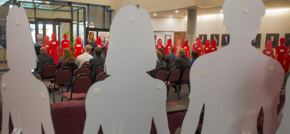 Leah Hogsten     The Salt Lake Tribune Victim Services Coordinator Rachelle Hill is surrounded by red and white silhouette cut-outs in lobby of West Valley City Hall that represent victims of domestic violence. The month of October is Domestic Violence Awareness Month and the West Valley City Police Department hopes to increase awareness about domestic violence.