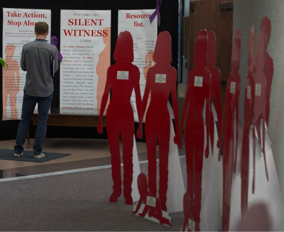 Leah Hogsten     The Salt Lake Tribune Red and white silhouette cut-outs fill the lobby of West Valley City Hall and represent victims of domestic violence and their stories. The month of October is Domestic Violence Awareness Month and the West Valley City Police Department hopes to increase awareness about domestic violence.