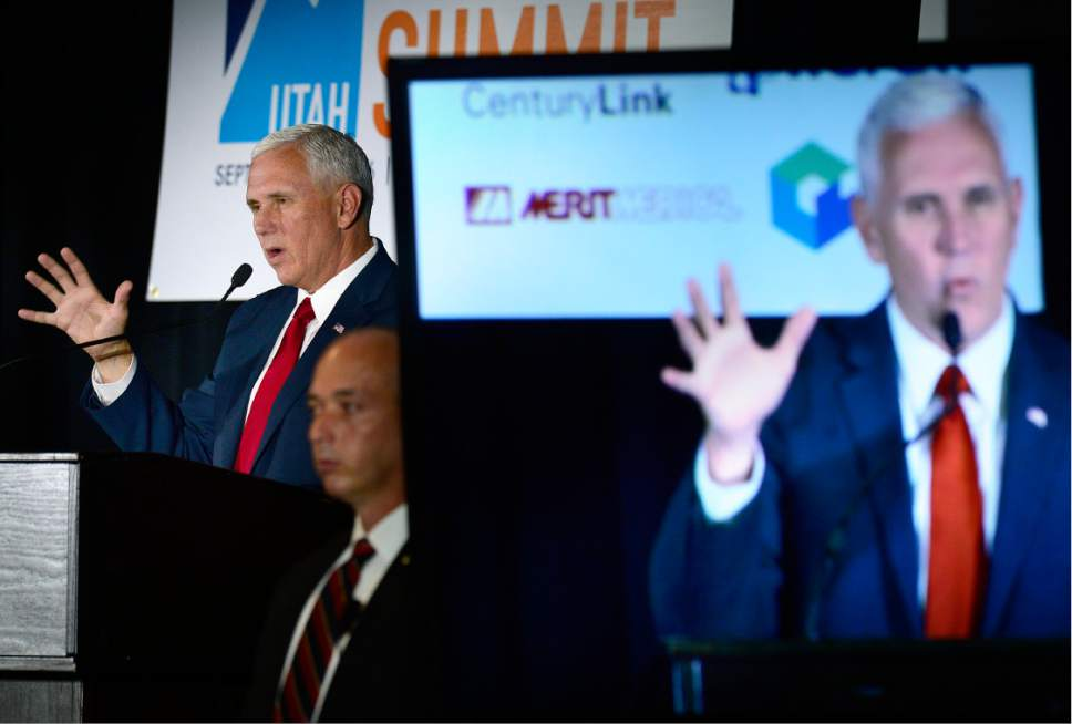 "Scott Sommerdorf   |  The Salt Lake Tribune   Indiana Governor Mike Pence speaks at ""Solutions Summit"" at Vivint Arena, Thursday, September 1, 2016."