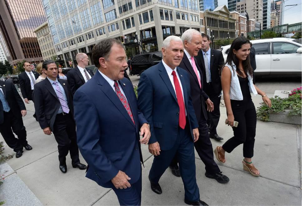 Scott Sommerdorf   |  The Salt Lake Tribune   Utah Governor Gary Herbert, Indiana Governor Mike Pence, and U.S. Senator Orrin Hatch walk together as a tour of Temple Square begins, Thursday, September 1, 2016.