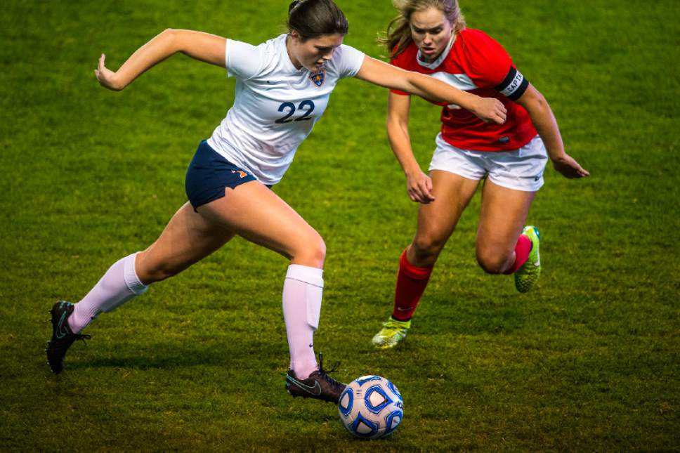 Chris Detrick     The Salt Lake Tribune Timpview's Kathryn Wynn (22) and East's Haley Farrar (3) go for the ball during the 4A girls' state soccer championship at Rio Tinto Stadium Friday October 21, 2016.