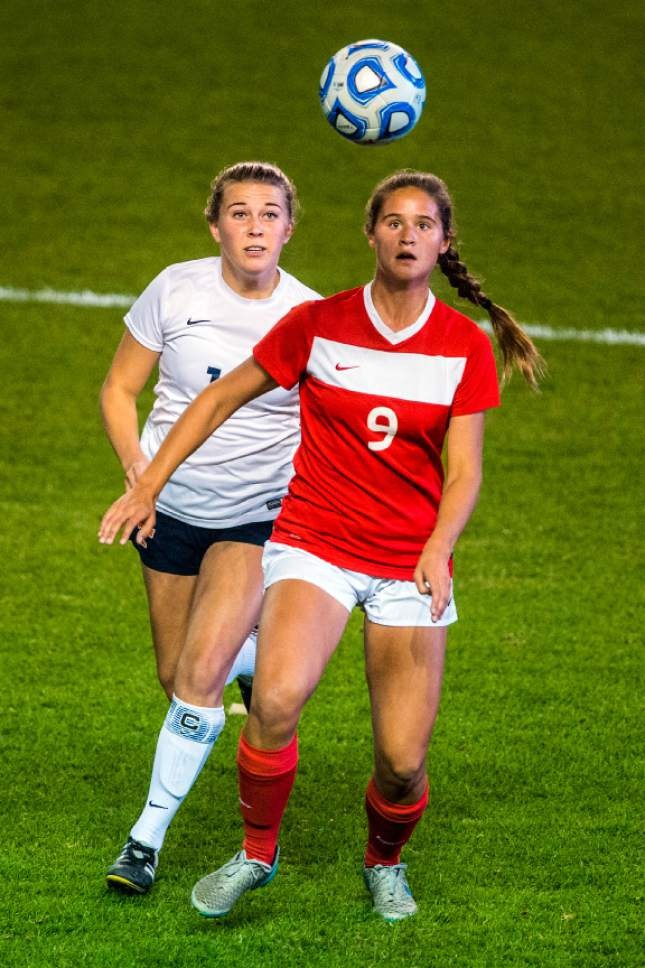 Chris Detrick     The Salt Lake Tribune Timpview's Kamryn Worthington (17) and East's Mia Thomas (9) go for the ball during the 4A girls' state soccer championship at Rio Tinto Stadium Friday October 21, 2016.