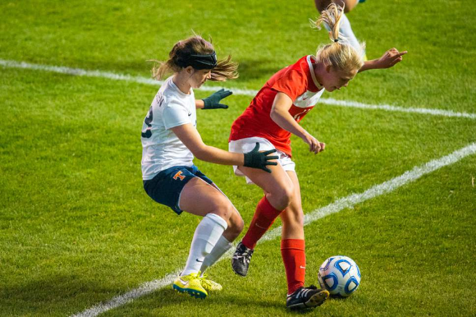 Chris Detrick     The Salt Lake Tribune Timpview's Kelsey Salvesen (33) and East's Sami Black (11) go for the ball during the 4A girls' state soccer championship at Rio Tinto Stadium Friday October 21, 2016.