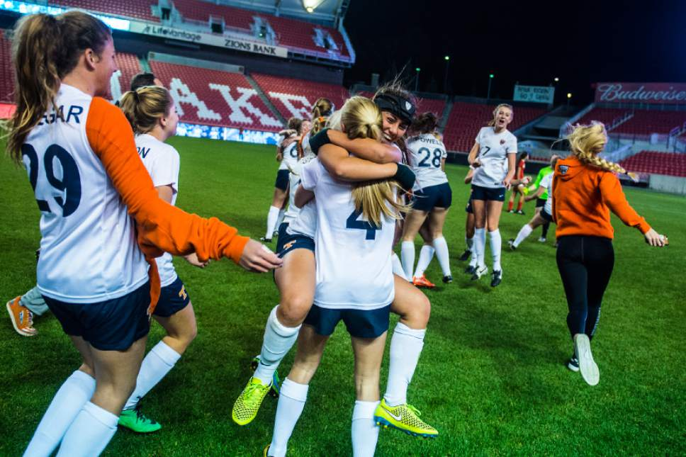 Chris Detrick     The Salt Lake Tribune Timpview's Kelsey Salvesen (33) and Timpview's Abby King (4) celebrate after defeating East 2-0 in the 4A girls' state soccer championship at Rio Tinto Stadium Friday October 21, 2016.