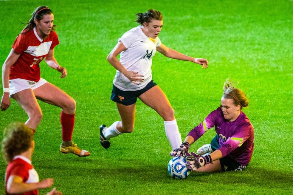 Chris Detrick     The Salt Lake Tribune East's Katie Liljenquist (0) makes a save on a goal attempt by Timpview's Dakota Smith (14) during the 4A girls' state soccer championship at Rio Tinto Stadium Friday October 21, 2016.