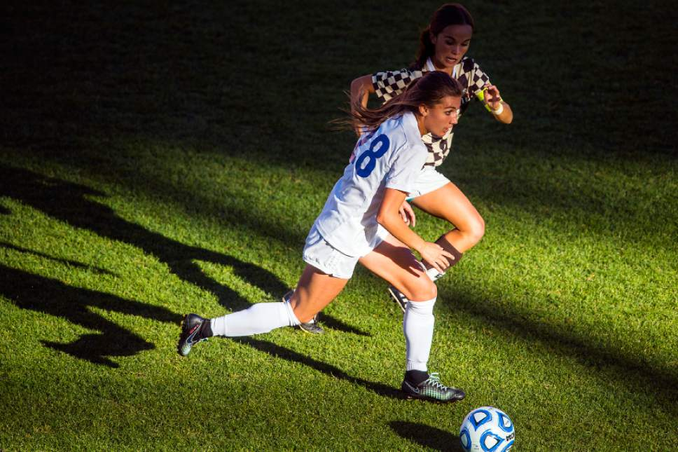 Chris Detrick  |  The Salt Lake Tribune Fremont's Courtney Talbot (28) and Davis' Ellie Robinson (9) go for the ball during the 5A girls' state soccer championship at Rio Tinto Stadium Friday October 21, 2016.