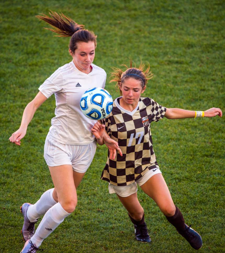 Chris Detrick  |  The Salt Lake Tribune Fremont's Katelyn Allen (9) and Davis' Zoe Jacobs (17) go for the ball during the 5A girls' state soccer championship at Rio Tinto Stadium Friday October 21, 2016.