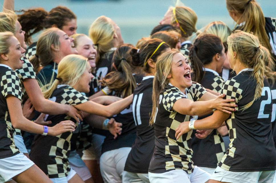 Chris Detrick  |  The Salt Lake Tribune Members of the Davis soccer team celebrate after defeating Fremont 2-1 in the 5A girls' state soccer championship at Rio Tinto Stadium Friday October 21, 2016.