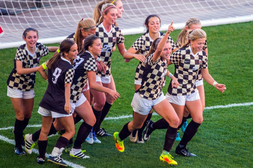 Chris Detrick  |  The Salt Lake Tribune Davis' Olivia Wade (10) celebrates with her teammates after scoring a goal during the 5A girls' state soccer championship at Rio Tinto Stadium Friday October 21, 2016.