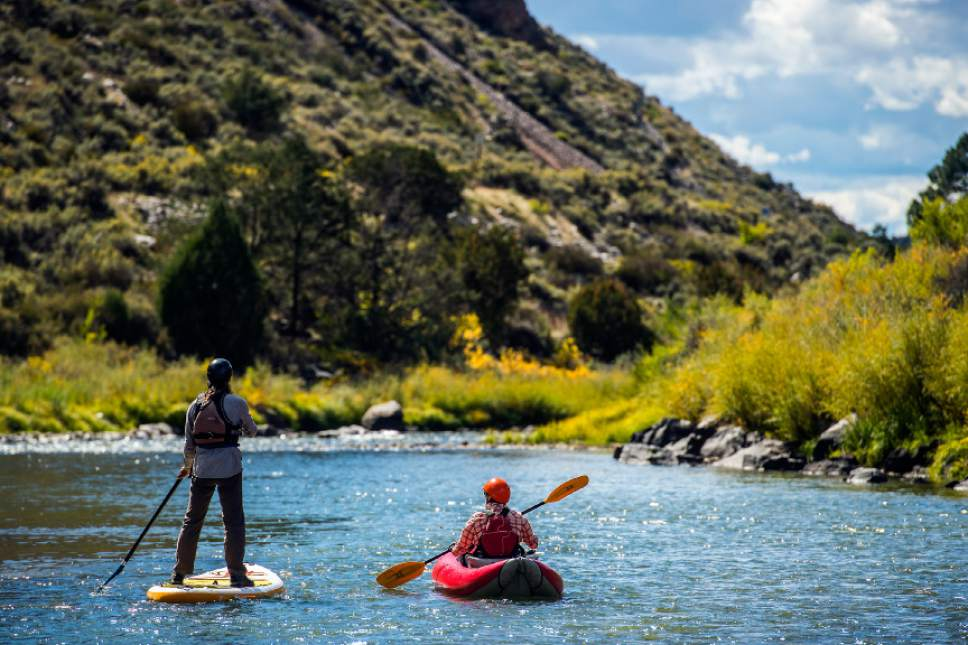 Chris Detrick  |  The Salt Lake Tribune Kim Chatfield, left, and Mia Jennings, stand up paddle board and kayak on the Rio Grande Gorge near Pilar, New Mexico Saturday October 1, 2016.