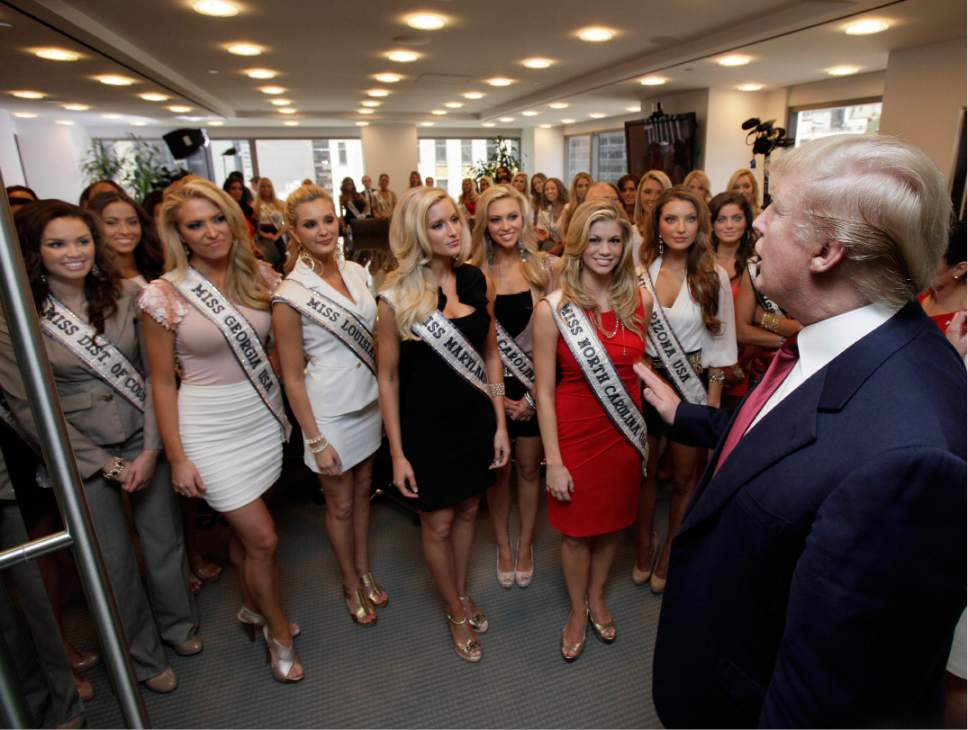 Donald Trump addresses Miss USA contestants in a conference room in Trump Tower, during their to New York, Wednesday, May 25, 2011. (AP Photo/Richard Drew)