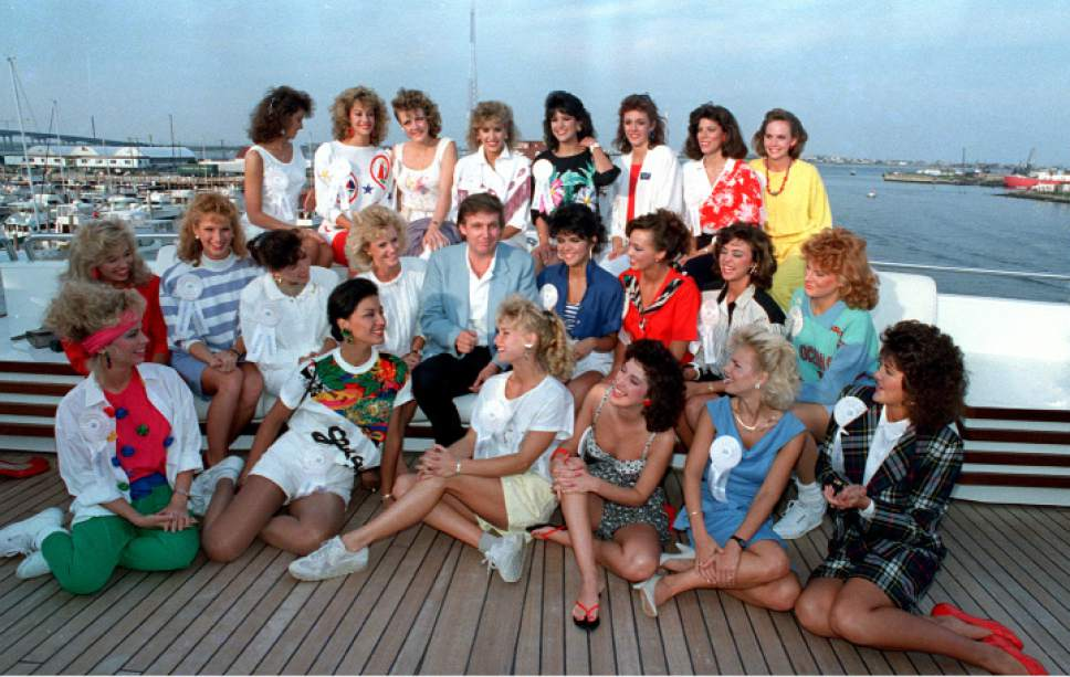 Developer Donald Trump poses with about half of the competing State Misses on board his yacht in Atlantic City, N.J., Sept. 4, 1988.  (AP Photo/Jack Kanthal)