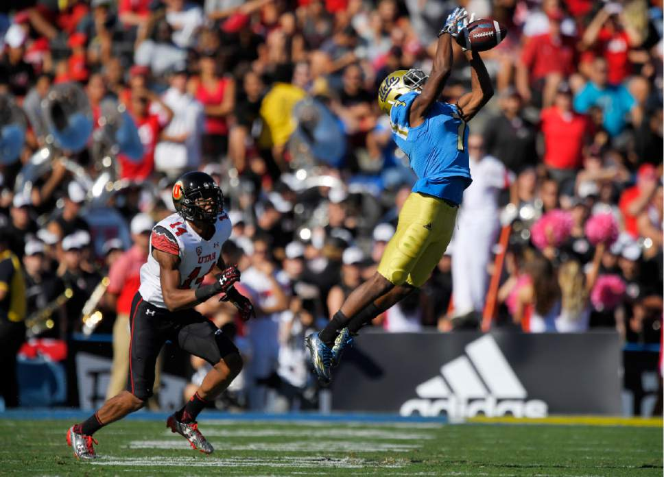 UCLA wide receiver Darren Andrews, right, can't hold on to a pass as Utah defensive back Brian Allen watches during the first half of an NCAA college football game, Saturday, Oct. 22, 2016, in Pasadena, Calif. (AP Photo/Mark J. Terrill)