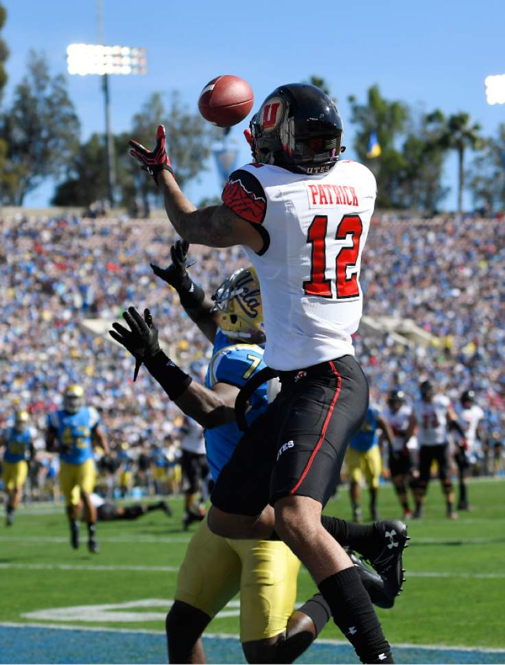 Utah wide receiver Tim Patrick, right, makes a catch in the end zone as UCLA defensive back John Johnson defends during the first half of an NCAA college football game, Saturday, Oct. 22, 2016, in Pasadena, Calif. The play was called back on a penalty. (AP Photo/Mark J. Terrill)