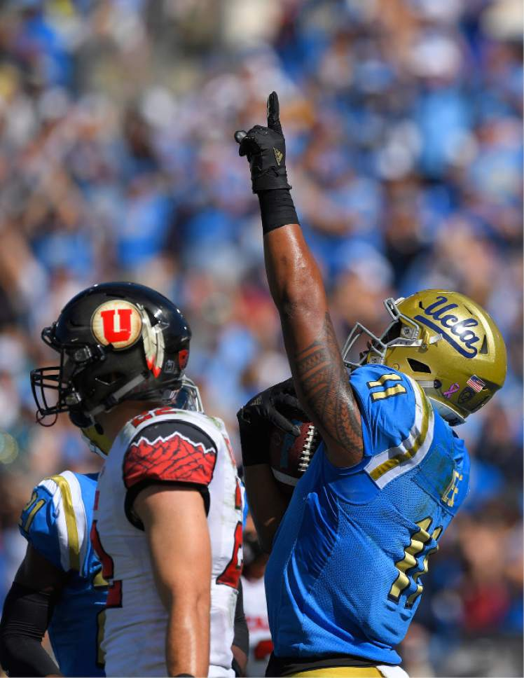 UCLA tight end Nate Iese, right, celebrates his touchdown as Utah defensive back Chase Hansen walks away during the first half of an NCAA college football game, Saturday, Oct. 22, 2016, in Pasadena, Calif. (AP Photo/Mark J. Terrill)