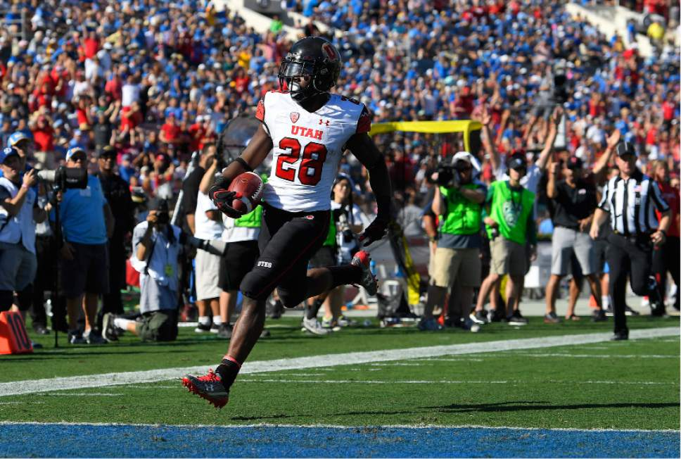 Utah running back Joe Williams runs in for a touchdown during the first half of an NCAA college football game against UCLA, Saturday, Oct. 22, 2016, in Pasadena, Calif. (AP Photo/Mark J. Terrill)