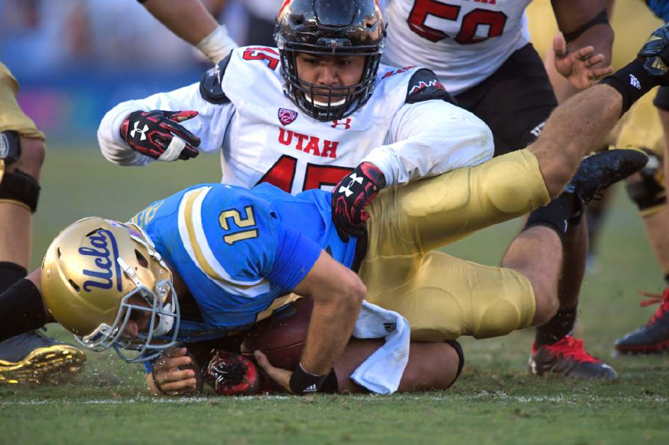 Utah defensive tackle Filipo Mokofisi, top, sacks UCLA quarterback Mike Fafaul during the second half of an NCAA college football game, Saturday, Oct. 22, 2016, in Pasadena, Calif. Utah won 52-45. (AP Photo/Mark J. Terrill)
