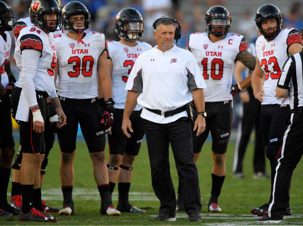 Utah head coach Kyle Whittingham stands with members of his team during the second half of an NCAA college football game against UCLA, Saturday, Oct. 22, 2016, in Pasadena, Calif. Utah won 52-45. (AP Photo/Mark J. Terrill)