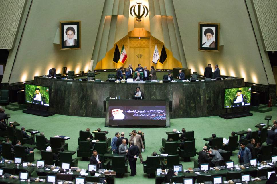 """Iranian Intelligence Minister Mahmoud Alavi, center, answers questions from lawmakers in an open session of parliament in Tehran, Iran, Tuesday, Oct. 25, 2016. Iran's intelligence minister is defending his agents' handling of a visit by a gay Utah state senator after hard-liners alleged it represented a security breach. Alavi said Sen. Jim Dabakis was under """"full surveillance"""" during his six-day visit in September. Alavi also questioned why hard-liners didn't have a problem with Dabakis making a 15-day visit in 2010 during the administration of hard-line President Mahmoud Ahmadinejad. (AP Photo/Ebrahim Noroozi))"""