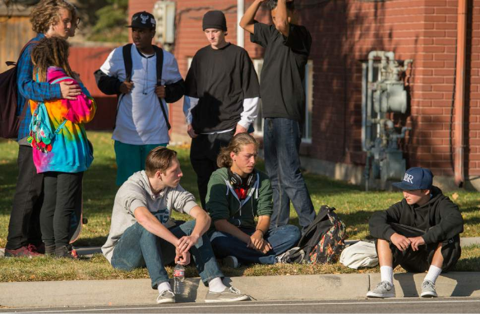 Leah Hogsten  |  The Salt Lake Tribune Kalani Matthews, 17, center, and friends watch the police scene across the street at Union Middle School. A 16-year-old boy was critically injured after being shot outside Union Middle School in Sandy by a 14-year-old, who is a student at the middle school. The shooting occurred about 3 p.m. when two teenage boys got into an argument on a field north of the school, said Sandy police Sgt. Dean Carriger. The victim -- who is a student at Hillcrest High School -- was transported by ambulance in critical condition to Intermountain Medical Center, where he went into surgery about 4:30 p.m. to treat two gunshot wounds. The 14-year-old suspect is in custody.