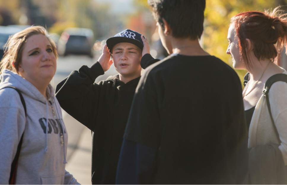 "Leah Hogsten  |  The Salt Lake Tribune ""He's alive?"" cried Mason Lewis, 14, with his hands on his head, after Dusti Rowland, left, and Rachel Otteson, 18, right, told him that a teen was recovering after surgery. Lewis said he ate lunch with the victim at Hillcrest High School hours before the shooting occurred. A 16-year-old boy was critically injured after being shot outside Union Middle School in Sandy by a 14-year-old, who is a student at the middle school.The shooting occurred about 3 p.m. when two teenage boys got into an argument on a field north of the school, said Sandy police Sgt. Dean Carriger. The victim ó who is a student at Hillcrest High School ó was transported by ambulance in critical condition to Intermountain Medical Center, where he went into surgery about 4:30 p.m. to treat two gunshot wounds. The 14-year-old suspect is in custody."