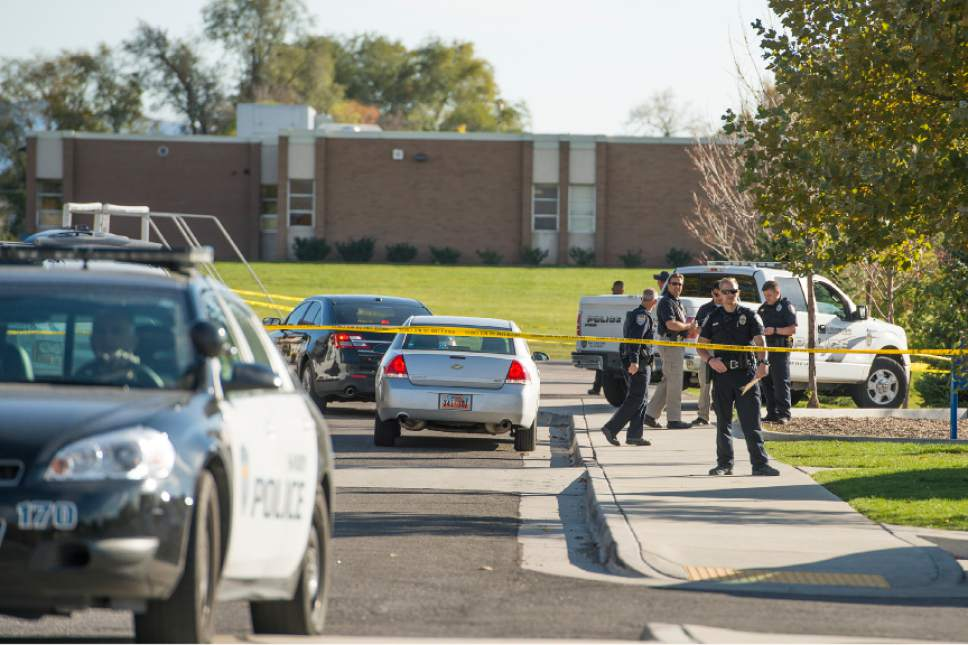 Leah Hogsten  |  The Salt Lake Tribune Police investigate a shooting last week in which a 16-year-old boy was critically injured at Union Middle School in Sandy. A 14-year-old who is a student at the middle school shot the older boy after the two got into an argument on a field north of the school, said Sandy police Sgt. Dean Carriger.
