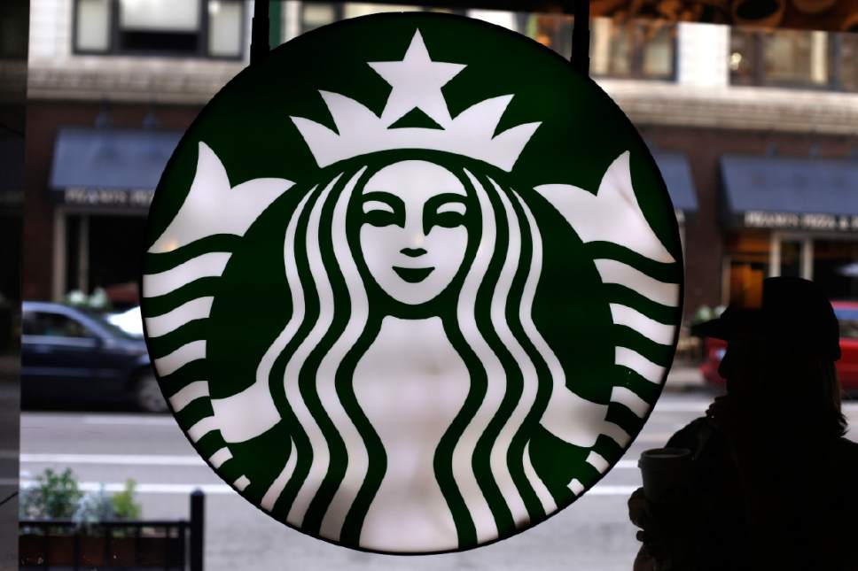 FILE - This Saturday, May 31, 2014, file photo, shows the Starbucks logo at one of the company's coffee shops in downtown Chicago. (AP Photo/Gene J. Puskar, File)