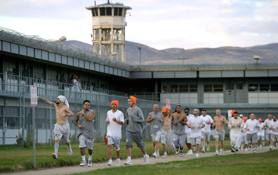 Al Hartmann  |  The Salt Lake Tribune Inmates at the Utah State Prison-Draper run the enclosed excercise yard-track for the Draper Invitational Marathon, Half-Marathon and 10K races Tuesday morning October 25.  110 times around the track for the full marathon.