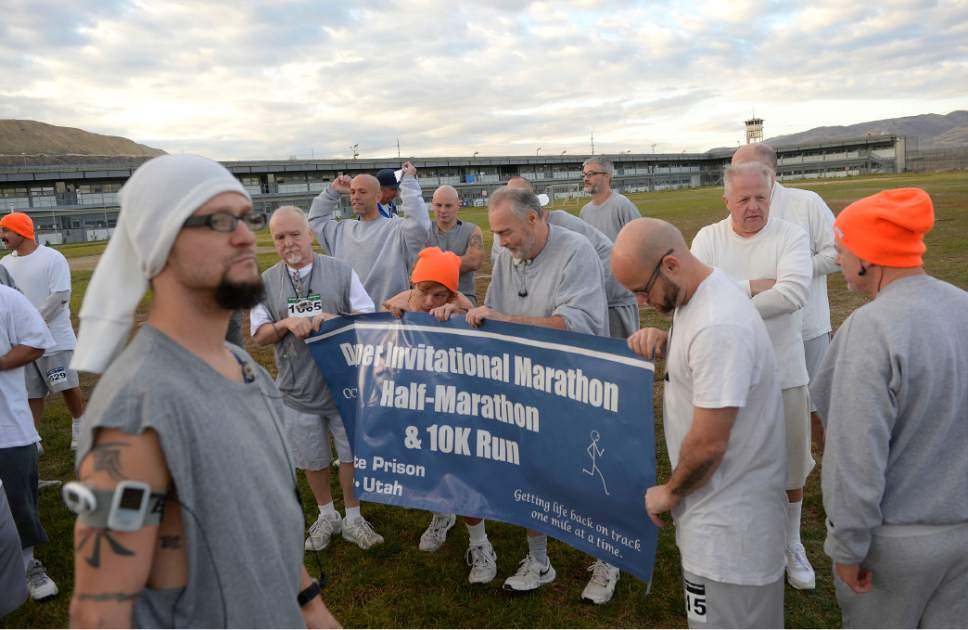Al Hartmann  |  The Salt Lake Tribune Inmates at the Utah State Prison-Draper gather for a group photo before the start of the Draper Invitational Marathon, Half-Marathon and 10K races Tuesday morning October 25.