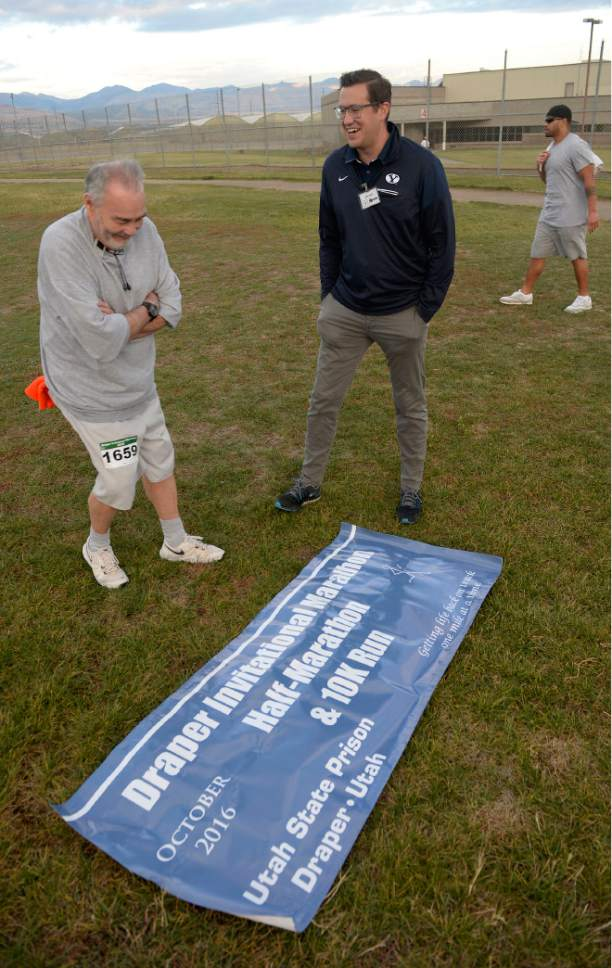Al Hartmann  |  The Salt Lake Tribune Isaac Wood, BYU's director of track and field operations, center, has been teaching a running clinic for inmates for the past two years.  He talks with Scott Cross if he's ready for the 10K race Tuesday morning October 25.