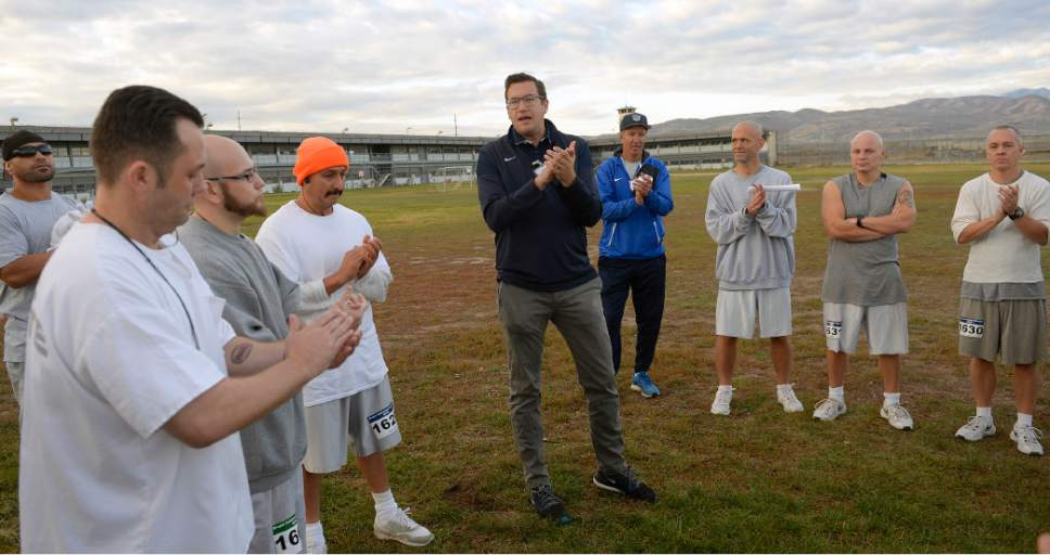 Al Hartmann  |  The Salt Lake Tribune Isaac Wood, BYU's director of track and field operations, center, has been teaching a running clinic for inmates at the Utah State Prison-Draper for the past two years.  He gives last minute instructions and pacing advice to  runners before the start of the Draper Invitational Marathon, Half-Marathon and 10K races Tuesday morning October 25.