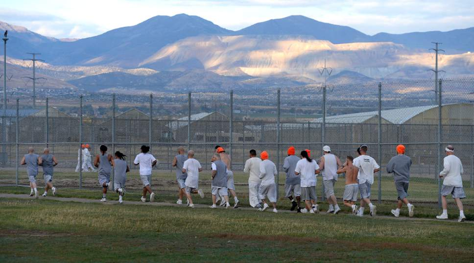 Al Hartmann  |  The Salt Lake Tribune Inmates at the Utah State Prison-Draper run the enclosed excercise yard-track at the start of the Draper Invitational Marathon, Half-Marathon and 10K races Tuesday morning October 25.
