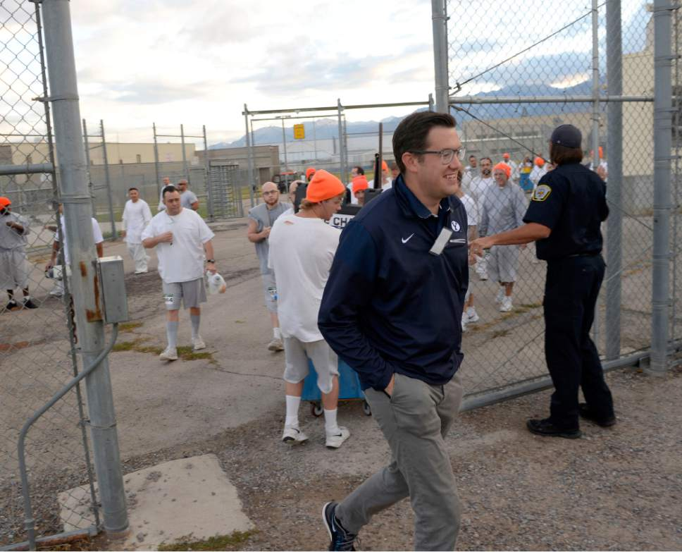 Al Hartmann  |  The Salt Lake Tribune Isaac Wood, BYU's director of track and field operations, has been teaching a running clinic for inmates for the past two years. Tuesday morning October 25 guard opens the gate to the excercise yard-track to run The Draper Invititational Marathon, Half-Marathon and 10K races.