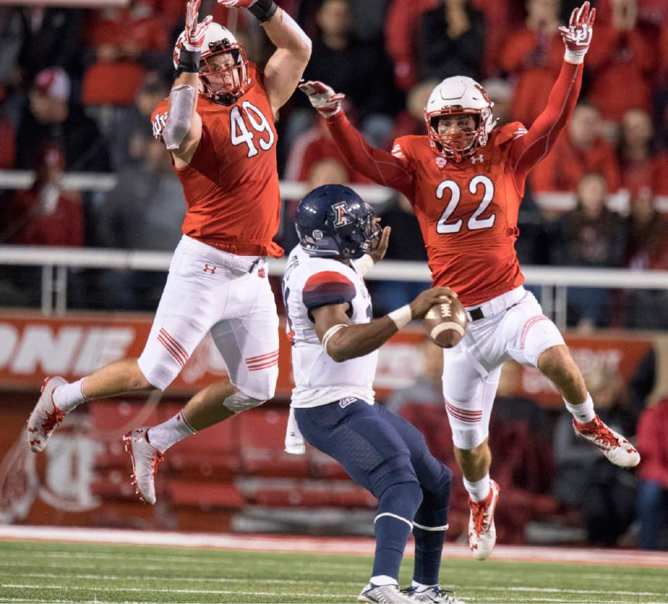 Rick Egan  |  The Salt Lake Tribune  Utah defensive end Hunter Dimick (49) and  defensive back Chase Hansen (22) put pressure on Arizona Wildcats quarterback Khalil Tate (14) in PAC-12 football action, Utah vs. The Arizona Wildcats, at Rice-Eccles Stadium, Saturday, October 8, 2016.