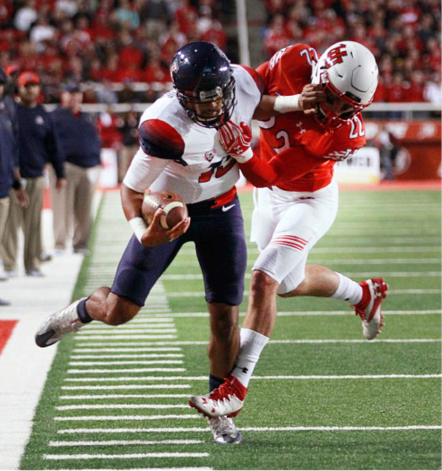 Arizona quarterback Brandon Dawkins (13) is driven out of bounds by Utah defensive back Chase Hansen (22) during the first half of an NCAA college football game, Saturday, Oct. 8, 2016, in Salt Lake City. (AP Photo/George Frey)