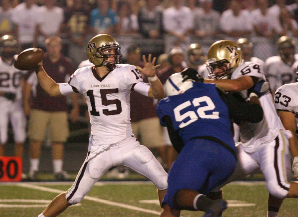 |  Tribune File Photo  Lone Peak quarterback Chase Hansen throws the ball. Bingham High Miners played Lone Peak High School at Bingham on Thursday, September 29, 2011.