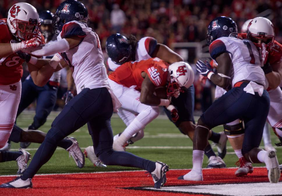 Rick Egan  |  The Salt Lake Tribune  Utah quarterback Troy Williams (3) runs for a second half touchdown for the Utes, in PAC-12 football action, Utah vs. The Arizona Wildcats, at Rice-Eccles Stadium, Saturday, October 8, 2016.