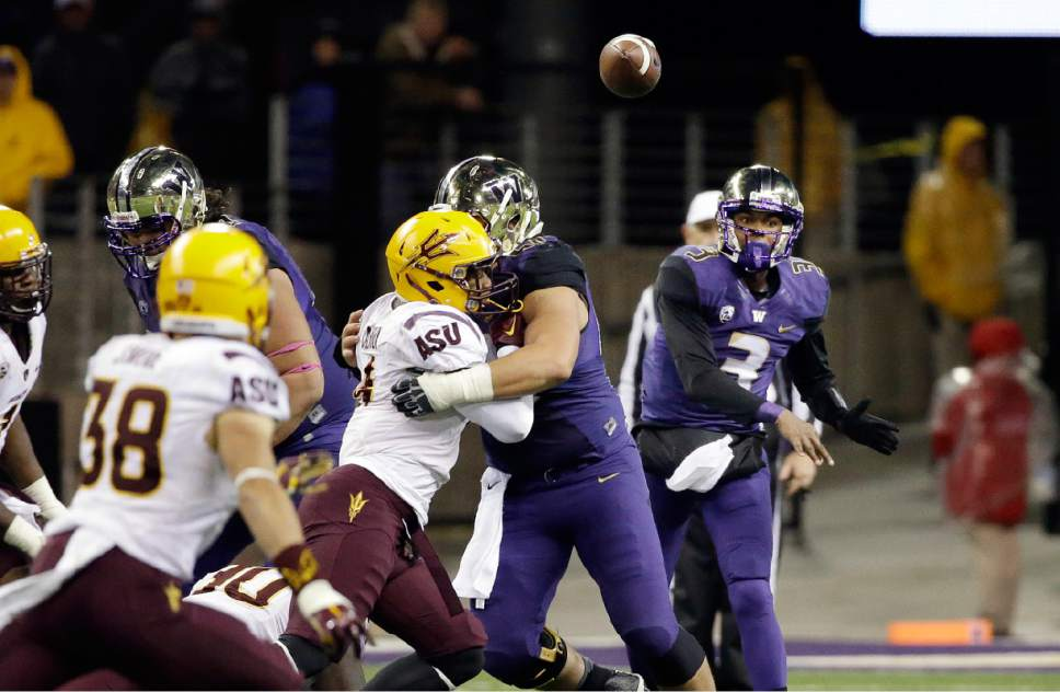 Washington quarterback Troy Williams (3) throws in the second half of an NCAA college football game Saturday, Oct. 25, 2014, in Seattle. Arizona State won 24-10. (AP Photo/Elaine Thompson)