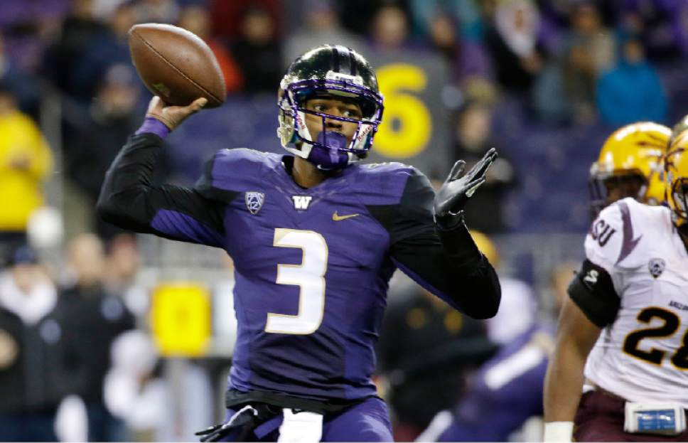 Washington quarterback Troy Williams drops back to pass against Arizona State in the first half of an NCAA college football game Saturday, Oct. 25, 2014, in Seattle. (AP Photo/Elaine Thompson)