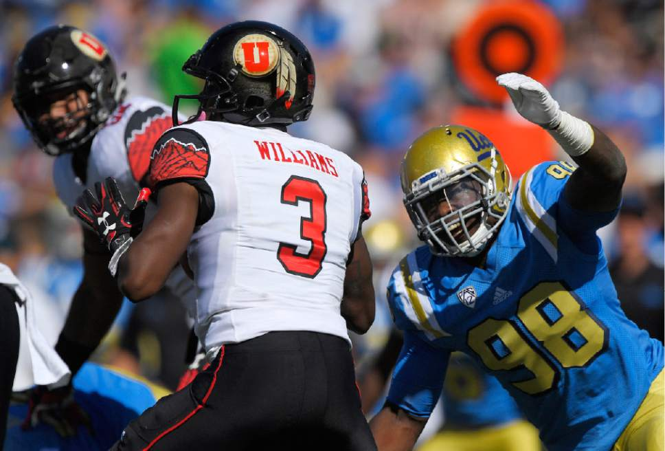 UCLA defensive lineman Takkarist McKinley, right, gets ready to sack Utah quarterback Troy Williams during the first half of an NCAA college football game, Saturday, Oct. 22, 2016, in Pasadena, Calif. McKinley also stripped the ball from Williams on the play. (AP Photo/Mark J. Terrill)