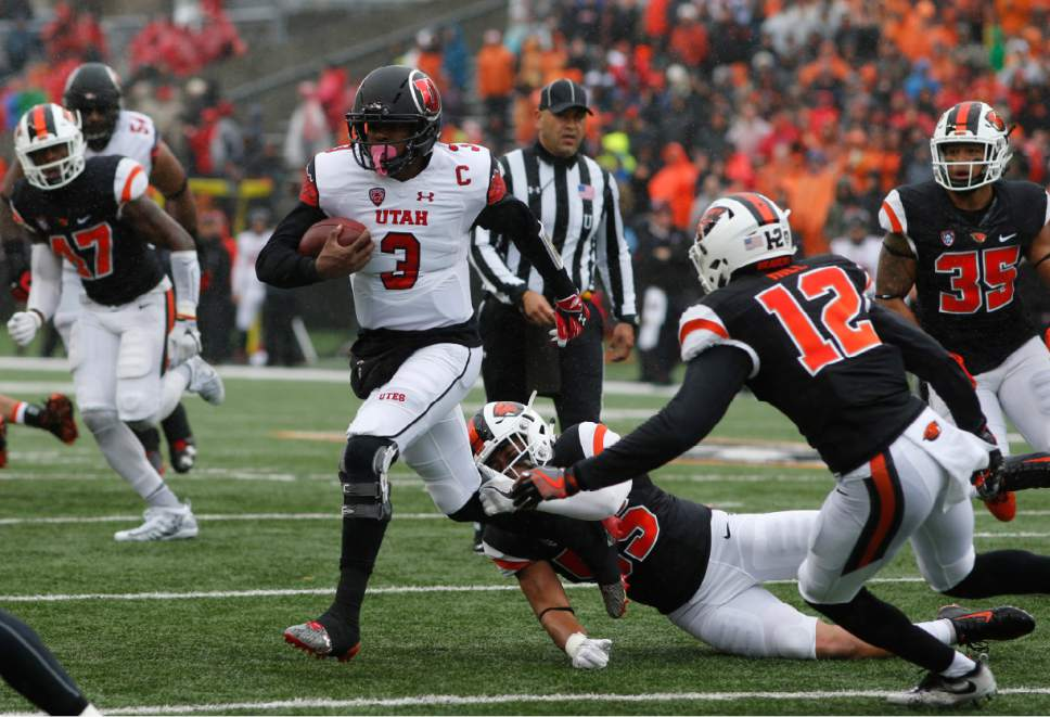 Utah quarterback Troy Williams (3) tries to pull away from Oregon State's Manase Hungalu, bottom, and Kendall Hill (12) in the first half of an NCAA college football game in Corvallis, Ore., on Saturday, Oct. 15, 2016. (AP Photo/Timothy J. Gonzalez)